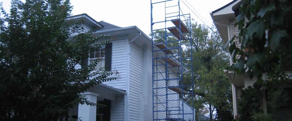 men rebuilding a chimney